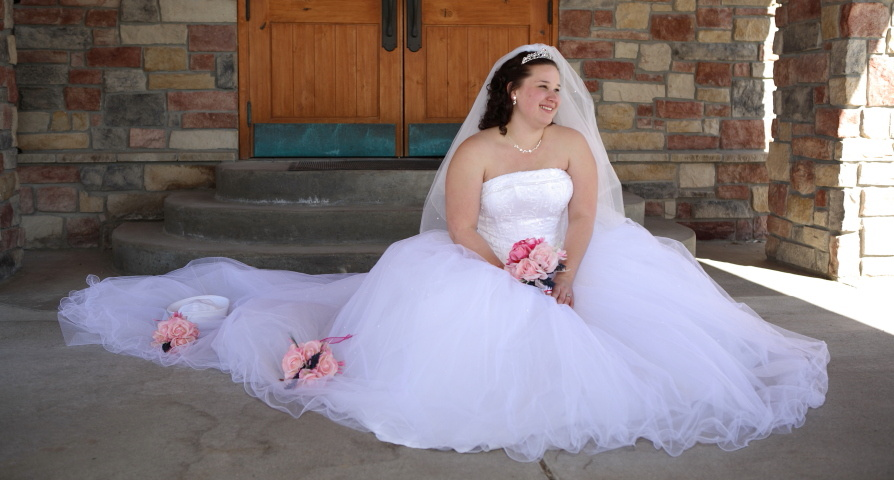 Bride sitting on the ground