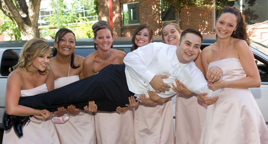 Groom held by bridesmaids